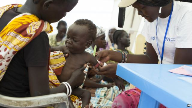 VOA File Photo: In this photo of Friday, July 25, 2014, a child with suspected malnutrition is examined at IMC nutrition program clinic in Malakal, South Sudan.